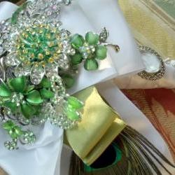 Apple green brooch bouquet with Peacock feather decor and pendant centerpiece